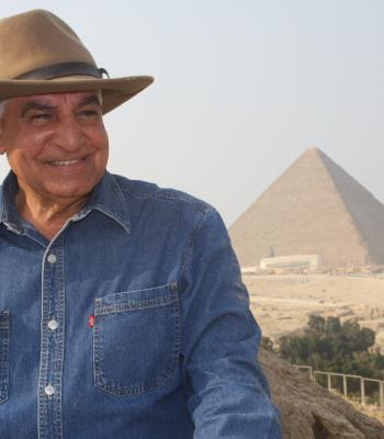 Dr. Zahi smiling in front of the Pyramids in Egypt
