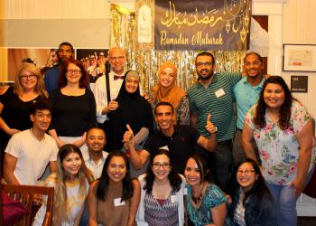 Group photo in front of Ramadan Kareem Banner