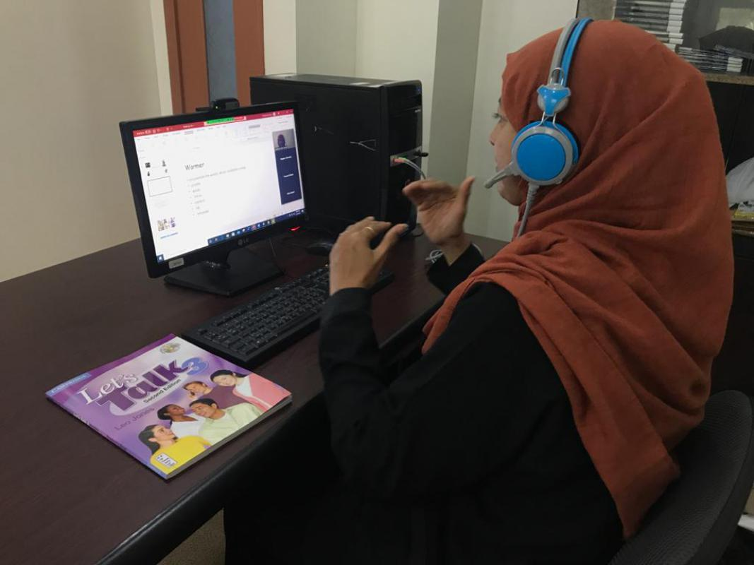 A female teacher gives lecture through Zoom App