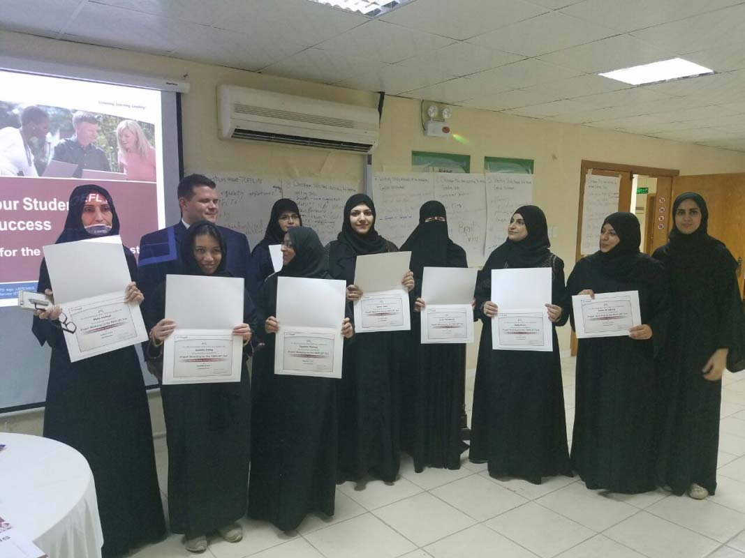 Picture of instructor awarding participation certificate