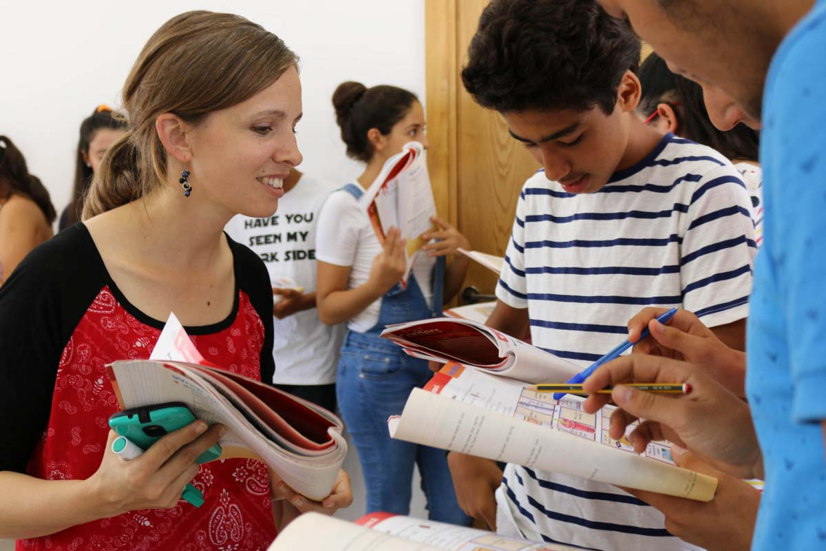 Teacher helps students with their classwork