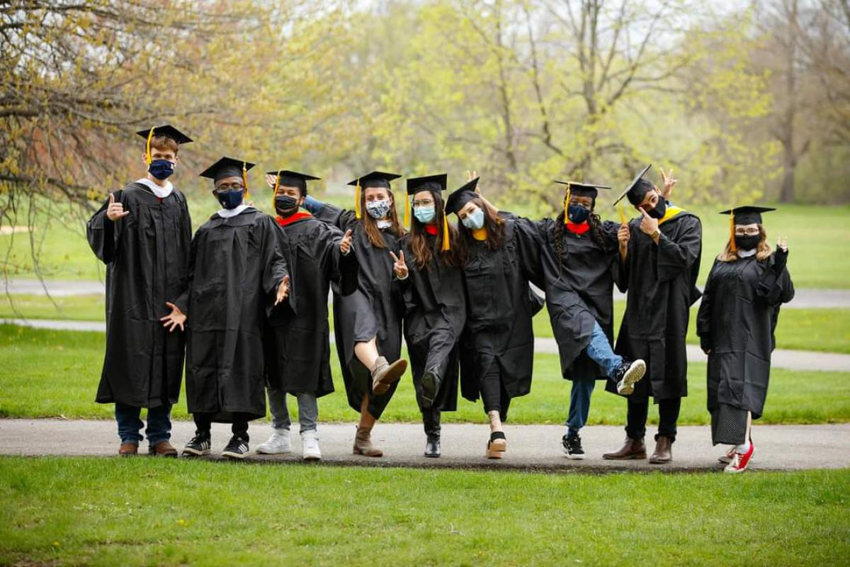 A group of graduating college students in their gowns.