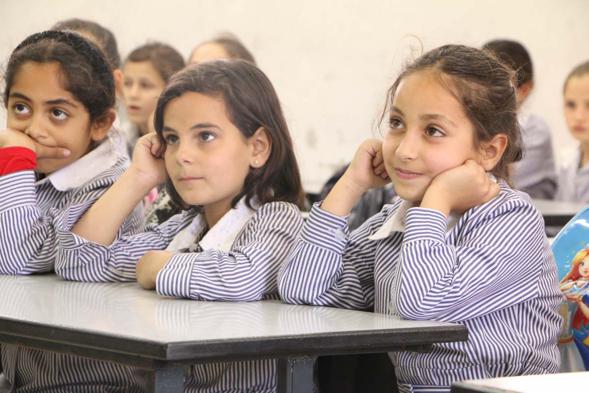 Young female students in a classroom setting