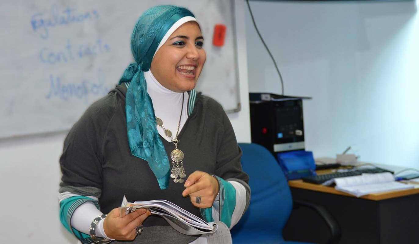 Teacher smiles while leading class