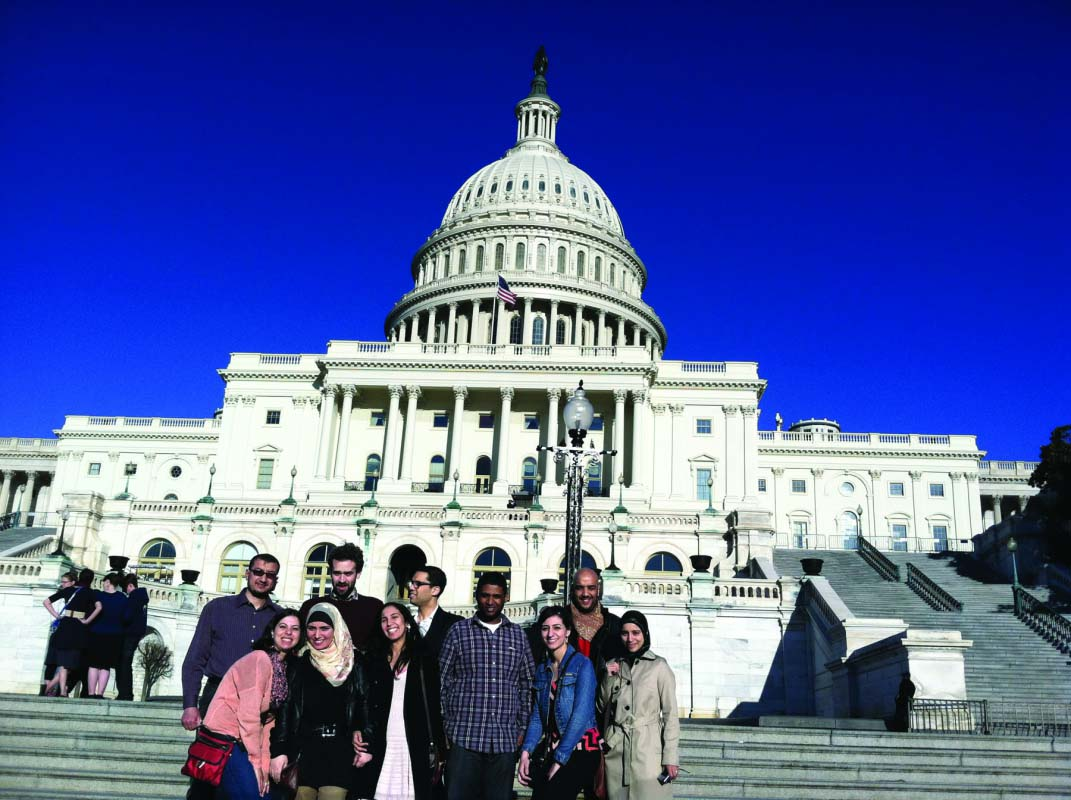 A group of Moroccans posing for a group photo outside the House of Congress in Washington D.C.