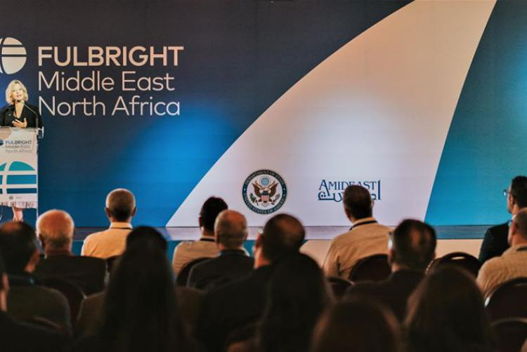 AMIDEAST 's country director for Tunisia, Jennifer Smith, delivering welcome remarks