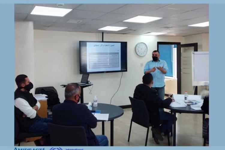 Male teachers in class room in a training