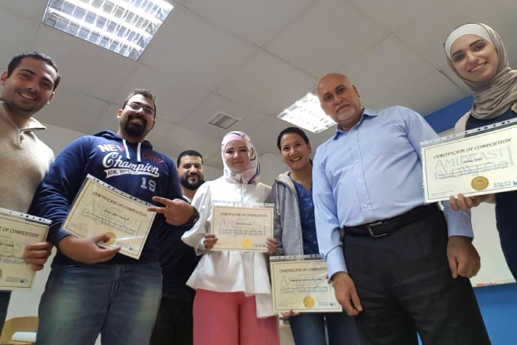 Students hold up certificates