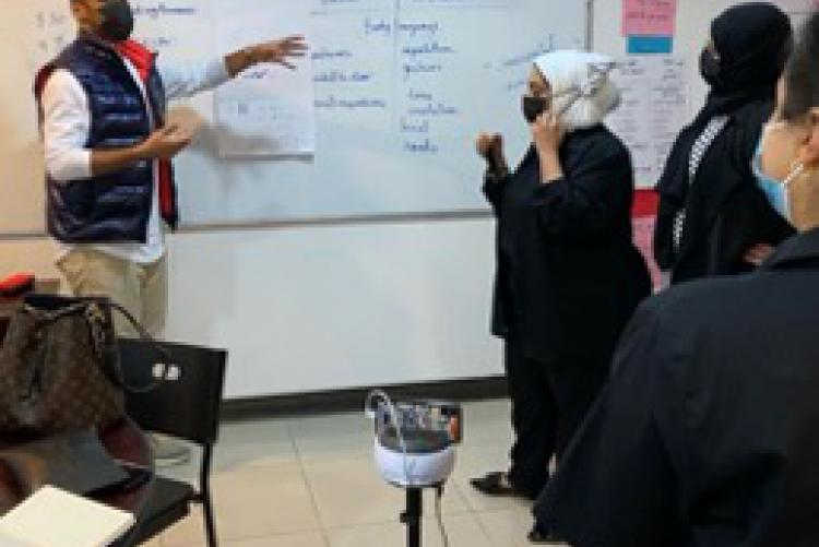Kuwaiti English teachers in a PCELT session assisted by a SWIVL robot