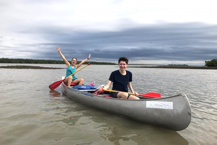 DKSSF student Nour and a friend riding in a canoe on a lake
