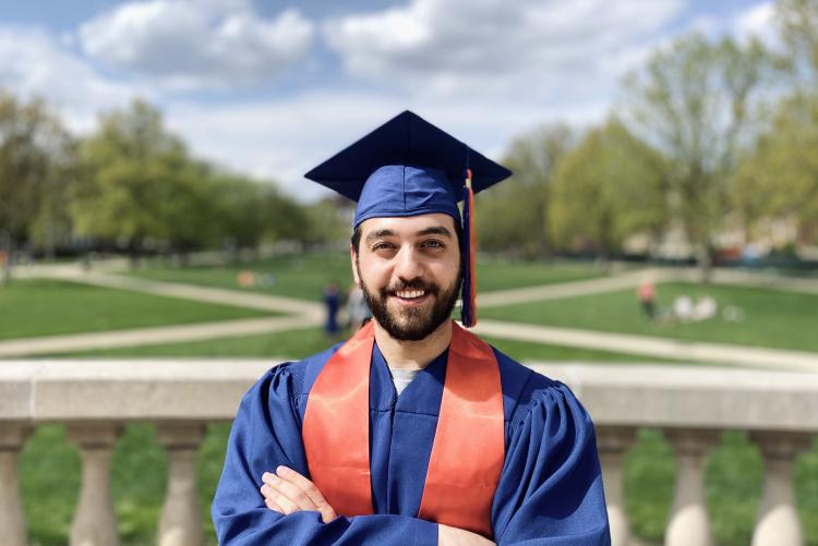 Male student in blue cap and gown