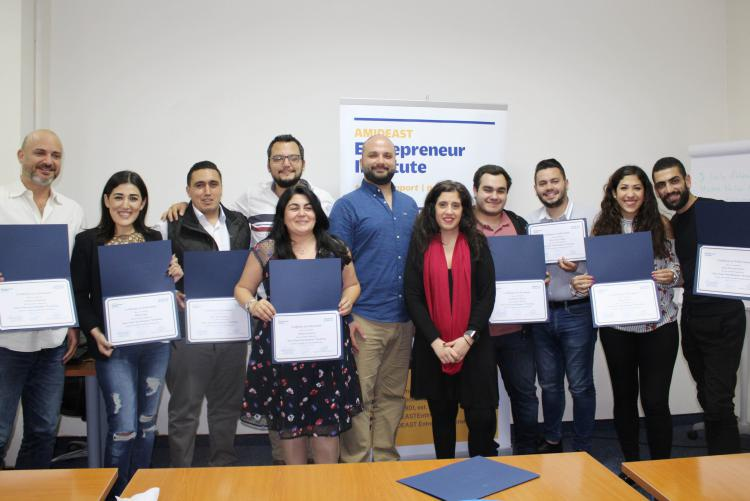 SYOB workshop participants holding their certificates