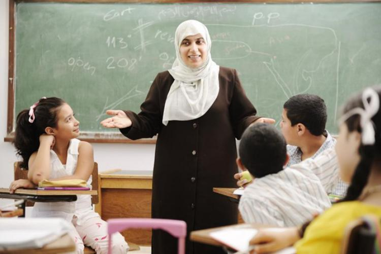 Female teacher in class with young kids