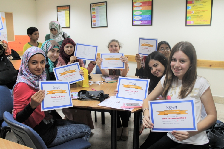 Students holding course completion certificates