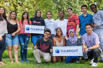 Group of students holding two Fulbright signs