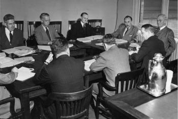 Table of men talking