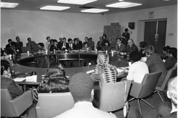 Group of people sitting at a round table
