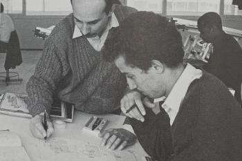 Teacher helping a student by writing something down