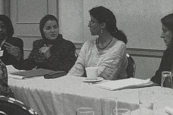 Four women sitting at a table