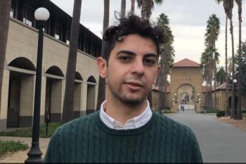 Abdallah AbuHashem by palm trees