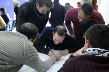 Arabic instructor helps a group of students with a language activity