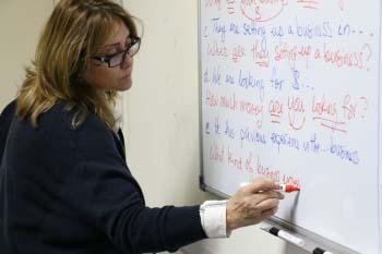 English Language teacher writing on the board
