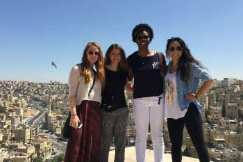Students standing together overlooking the city of Amman
