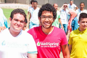 Male students in the HEI program smile at the camera