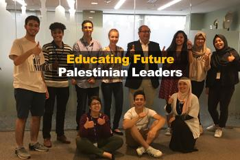 """A group of students pose with the text """"Educating Future Palestinian Leaders"""" over them"""