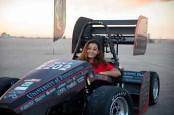 young woman in a racecar