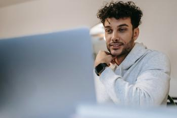 Young man at computer taking a test.