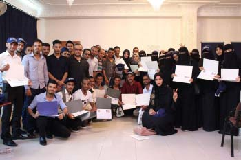 A large group of Nahdhat Shabab graduates pose with their certificates