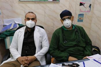 Two male nurses wearing masks
