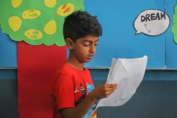 Student reading from a paper
