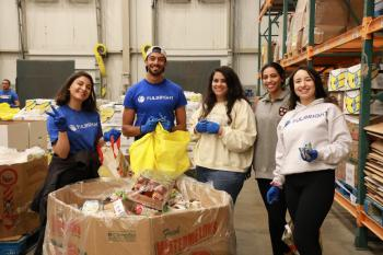 Group of Fulbright program students volunteering at food bank