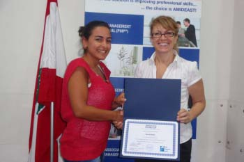 Two women hold up CAPM certificate
