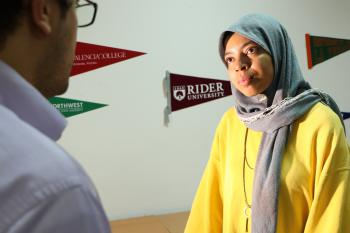 A moroccan youth listens to the Education USA Advisor