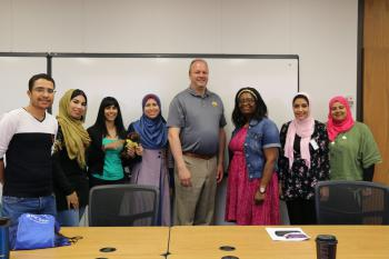 A group of scholars pose with their mentors.