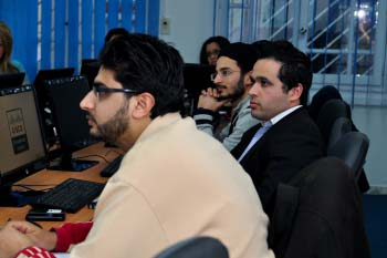 company staff look attentively towards their teacher who is offscreen