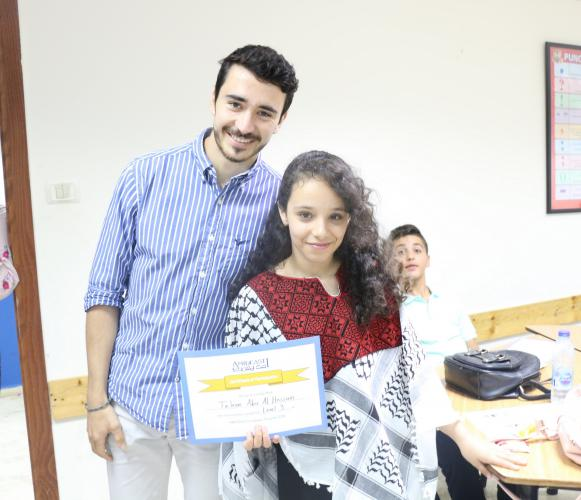 Student and teacher holding course certificate