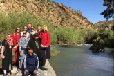 A group of student on the bank of the river in Zawiyat Ahansal, Morocco