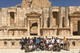 A group of students in the Roman amphitheater at Jerash in Jordan