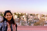 A summer 2018 student with the vista of Amman, Jordan behind her