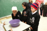 Three students watching a science experiment