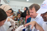 Teachers work with campers as they do a science experiment