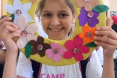 Camper holds up craft project