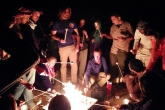 Students roast marshmallows over a fire in Wadi Rum, Jordan