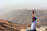 A student doing a yoga pose on Mount Toubkal in Morocco