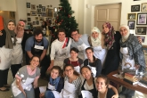 A group of students gather together to cook a traditional Jordanian meal