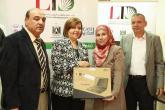 School principle receiving donation of  laptops for a school